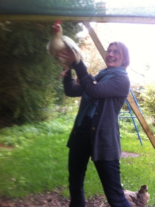 hold a chicken in the air